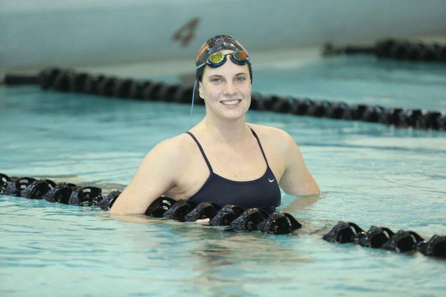 Freshman swimmer breaks records, barriers