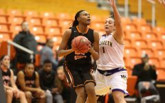 Women's hoops brushes past Houghton, 64-59