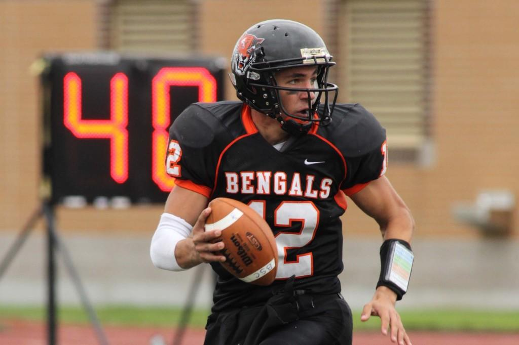 Quarterback+Casey+Kacz+accounted+for+461+yards+of+total+offense+and+one+touchdown+in+the+Bengals%27+victory+over+Brockport+on+Saturday.