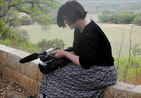 Associate COM professor Meg Knowles, hard at work on her current documentary project, entitled
