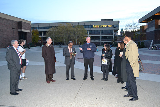 Provost Dennis Ponton, Vice President Hal Payne, and USG President Eric Sauerzopf join President Howard Cohen and other campus members on a walk through the campus to talk about lighting, and safety.