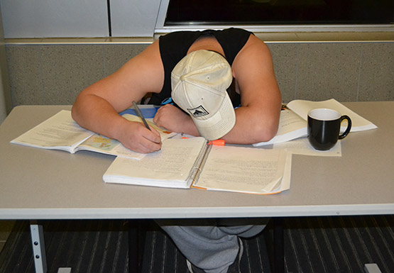 John Nickerson, a sophomore sociology major, demonstrates what not to do during finals week. Procrastinate less, plan more and tackle small tasks to achieve the highest grade possible.