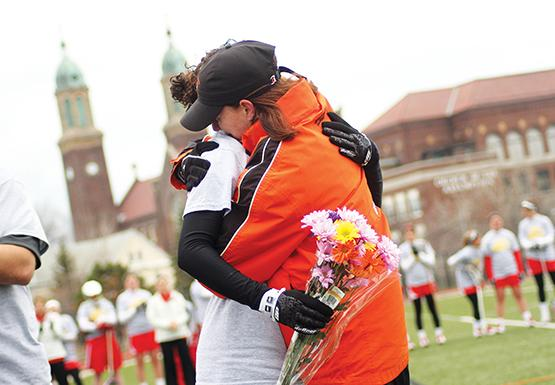 Ashley Caporizzo embraces coach Meg Stevens before the Bengals' senior game against Cortland Saturday. The game also served as a remembrance of Molly Seifritz, who passed away from Ewing's sarcoma in March.