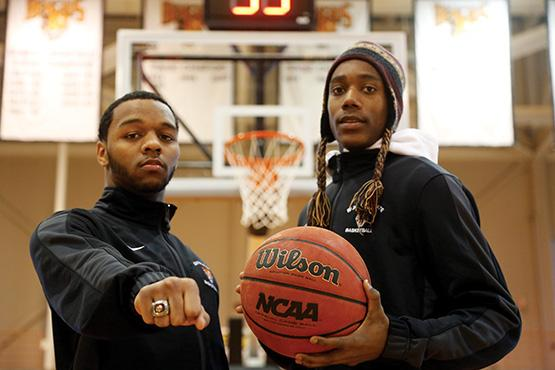 Rey Jordan shows off his Class A New York State championship ring next to high school and Buffalo State teammate Lovell Smith (right, in hat). The pair made history at nearby McKinley High School almost exactly a year ago, helping the school to its first-ever state championship.