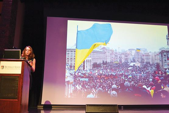 Slavka Kutsay presents photos detailing experiences protesting for social changes in Kylv, the center of the