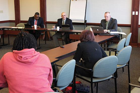 Consultants continue to investigate as firm holds open forums for students and faculty