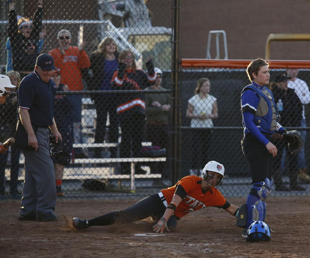 Buffalo States Kate Brownell scores the game-winning run to propel the Bengals to a 5-4 victory over Fredonia.