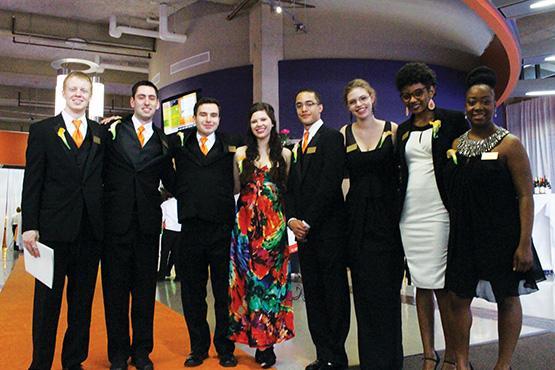From left to right, honor students Michael Filipski, Tim Anderson, Tim Schuler, Devan Brady, Jordan Sims, Tiffany Basset, Tiffany Guines, Azda Beda.