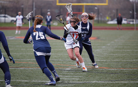 Lax loses pair, eliminated from playoff contention
