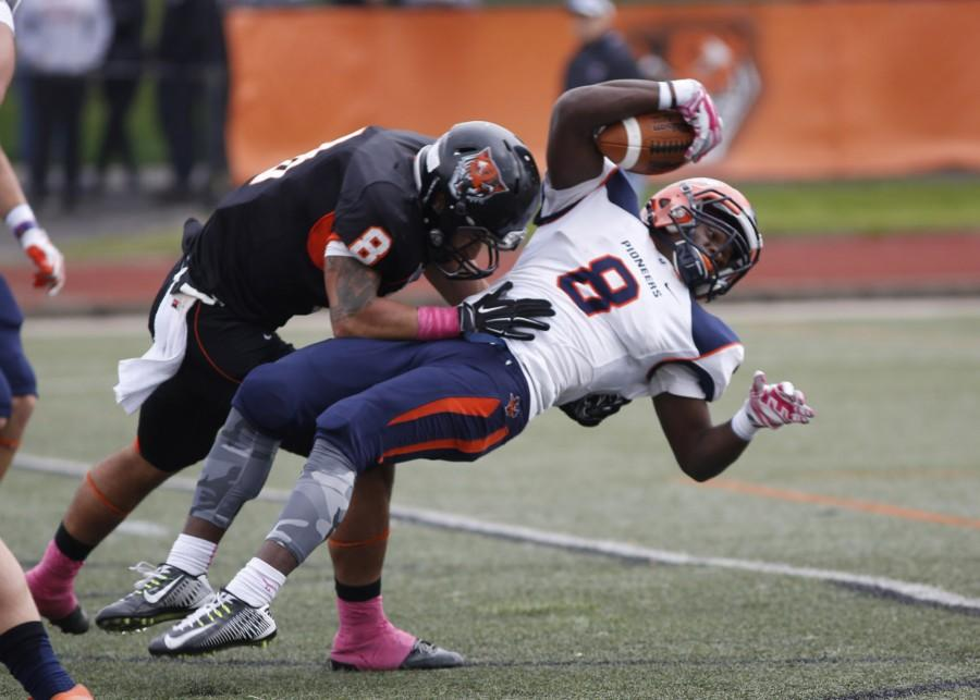 Uticas JVon Evans dives across the goal line for a 21-yard touchdown run with three seconds left in the first half.