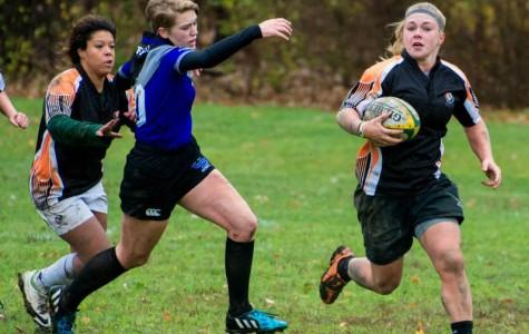Molly Gorski runs the ball against UB
