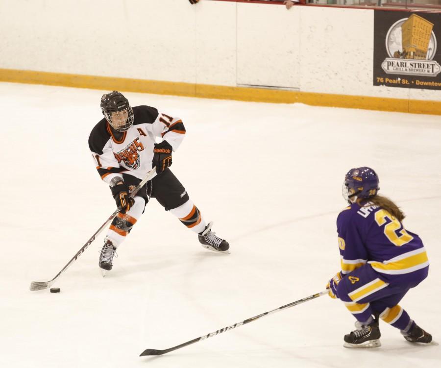 unior defenseman Nikki Kirchberger carries the puck into the zone against Elmira.