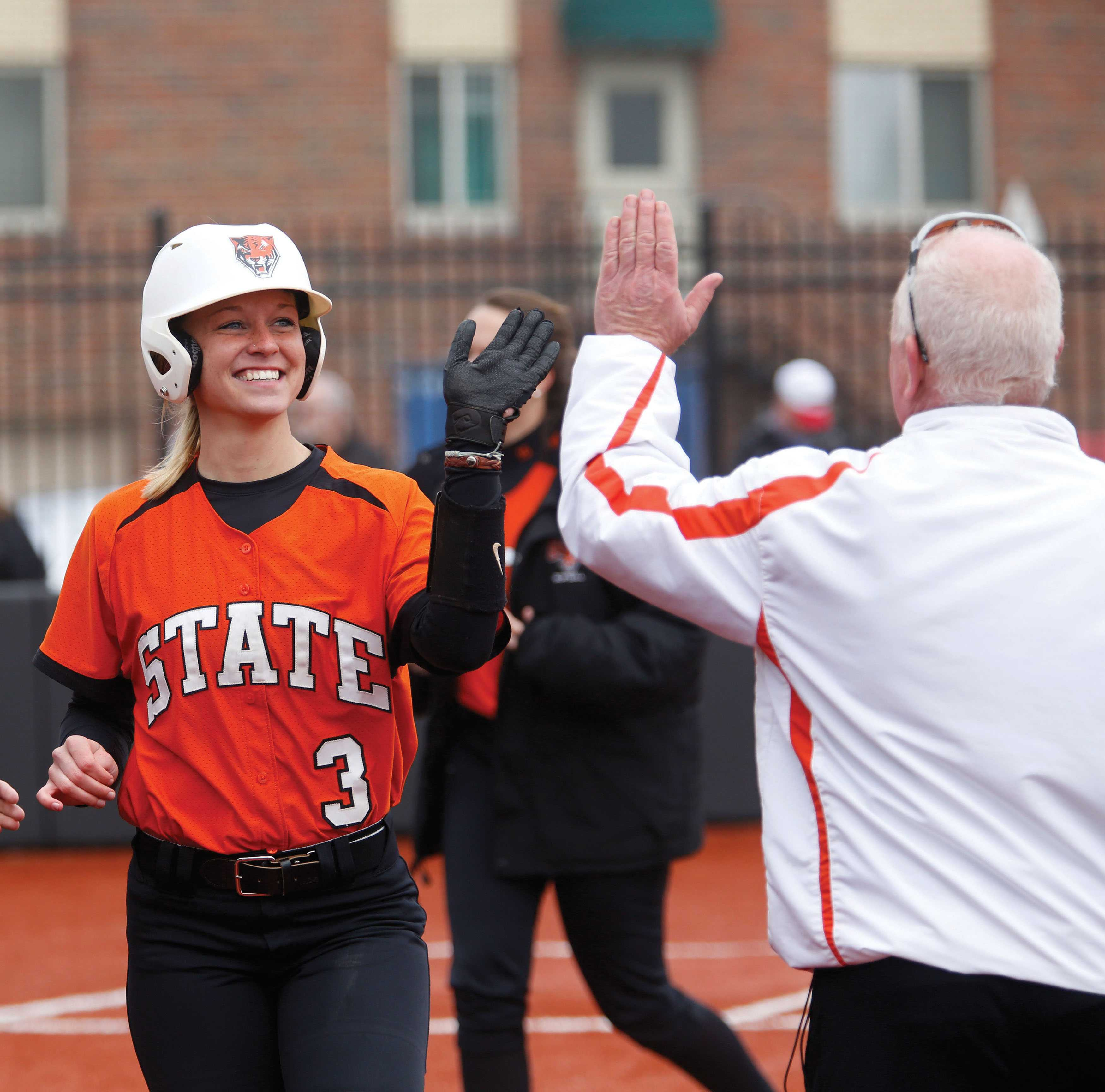 Senior Joanna Bardak high-fives assistant coach Greg Willats after hitting a go-ahead home from against Plattsburgh