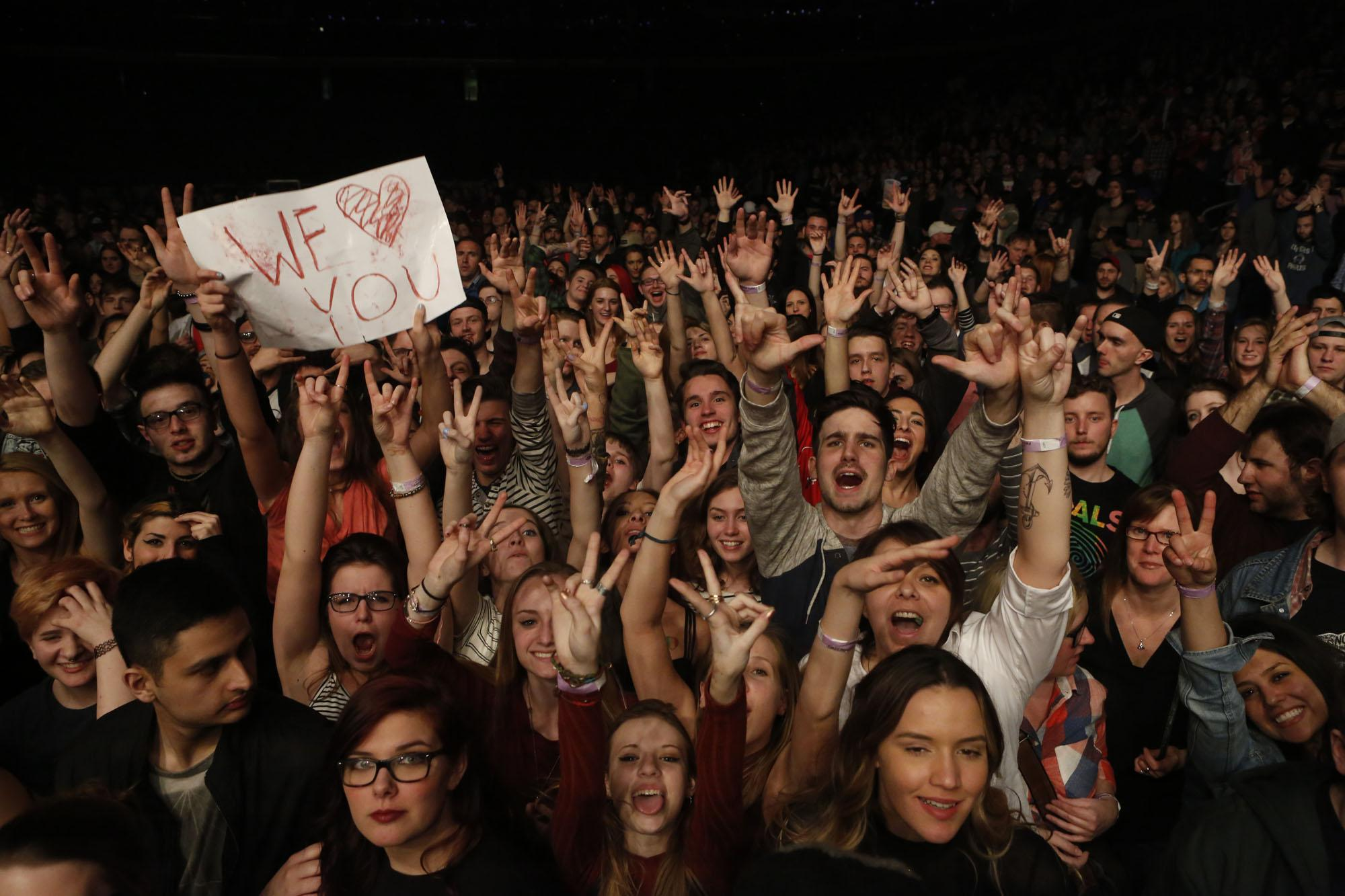 Alt. Buffalo fans get rowdy for a photo during Cage The Elephant's encore performance on March 28.