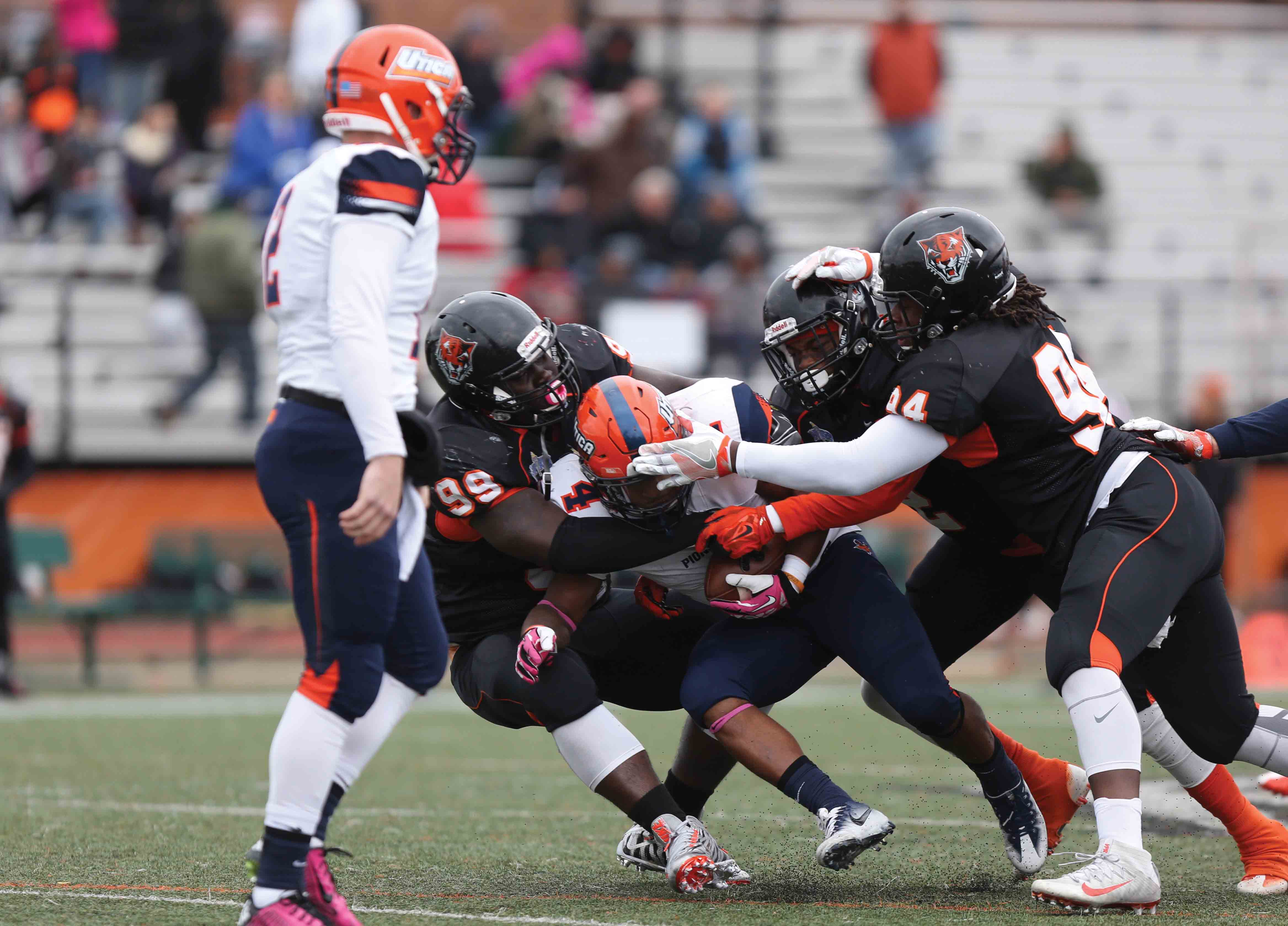 strong 'd' leads football to victory in season opener - the record