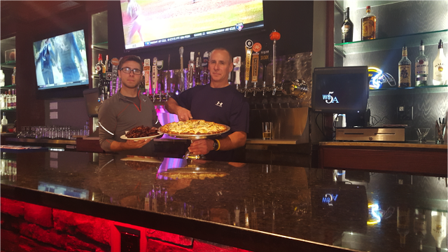 Michael+Rizzo+Jr.+%28left%29+stands+with+owner+Michael+Rizzo+%28right%29+holding+their+featured+barbeque+wings