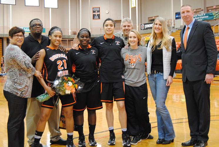 The+Lady+Bengals+pose+with+their+family+and+head+coach+Kevin+Clifford+after+a+win+on+Senior+Night.