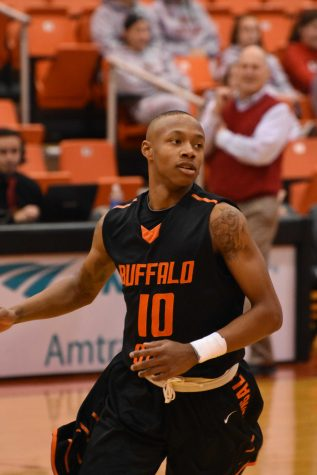 Men's basketball blows first-half lead, clinches playoff berth in loss