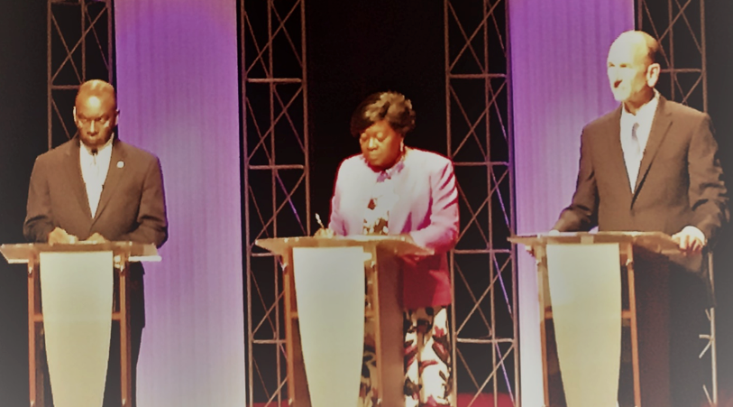 Photo by Tara Hark / All three Mayoral candidates take the stage in a debate .