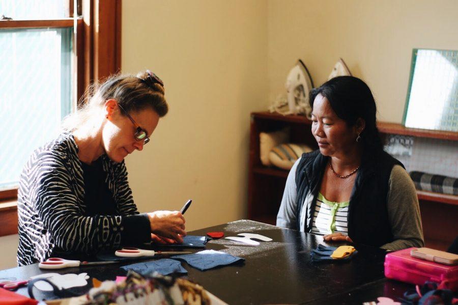 Stitch Buffalo founder Dawn Hoeg helps a