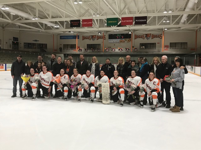 The+senior+women%27s+hockey+players+line+up+for+photos+with+their+families+after+the+Senior+Day+game.