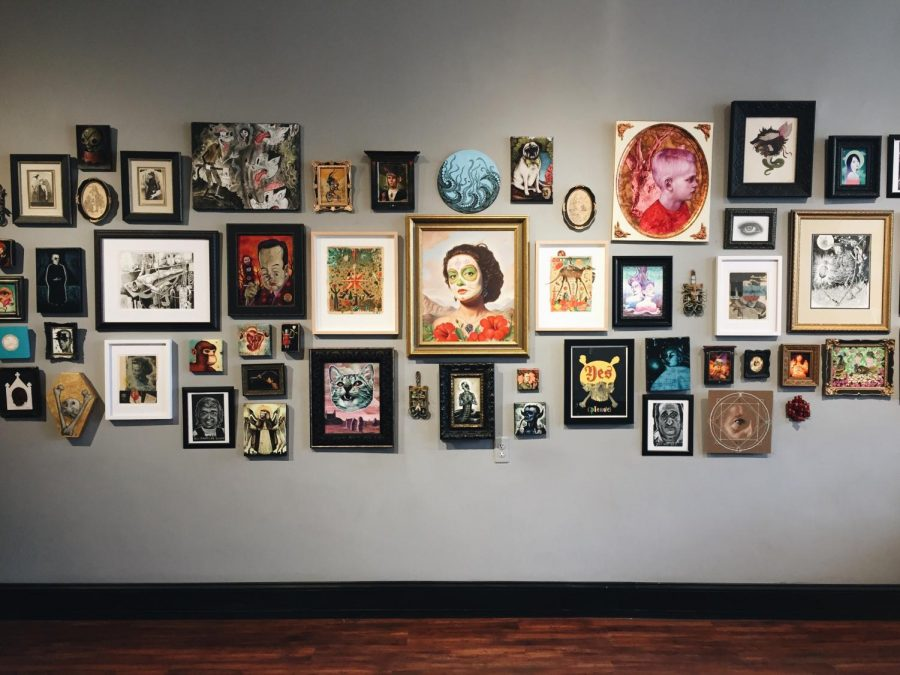 This wall of art is a mainstay in their gallery, but the individual works are always changing.