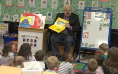 PHOTO GALLERY: Dr. Gordon reads to students at Childcare Center
