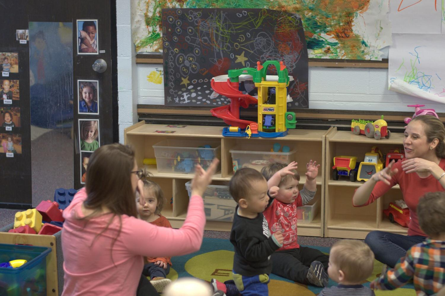 Volunteers from the Musical Education Department sing songs and share their skills with the children at the Buffalo State Childcare Center, in celebration of The Week of the Young Child.