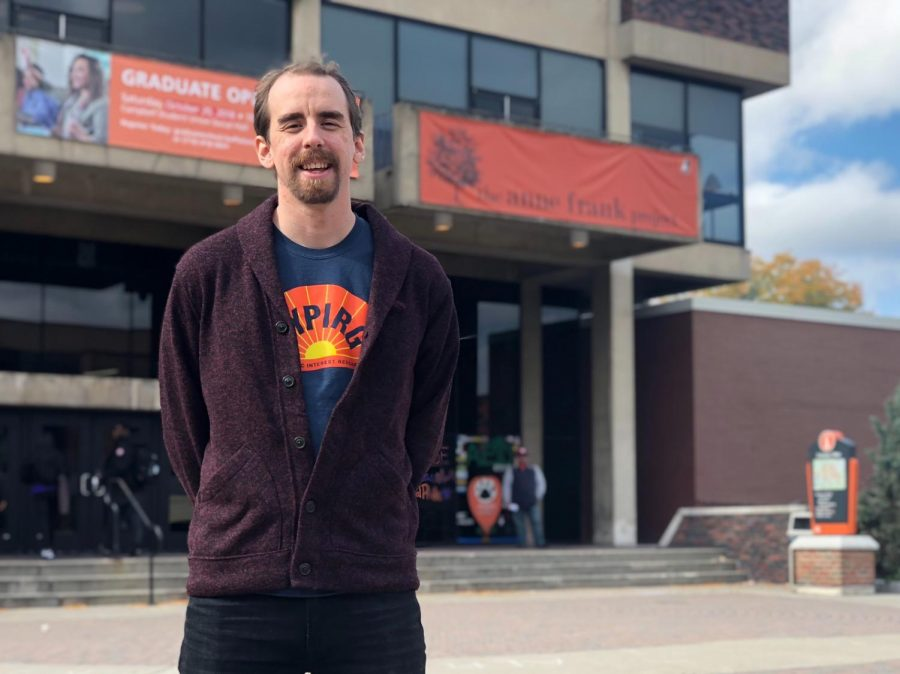 Scott Benedict stands in front of SUNY Buffalo State's Campbell Student Union, where he hopes students' new polling place will be November 2019.