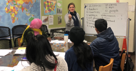 Students learn English during ESL class at Jericho Road.
