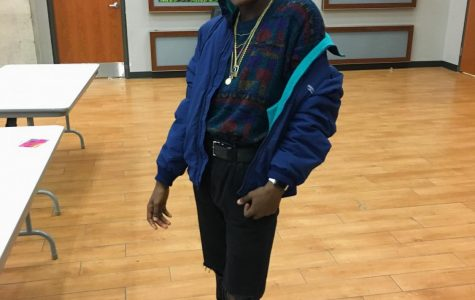 Model: Derric Jordan Trend: Bomber Jacket, Baggy Clothes and Boots Derric's outfit consists of an oversized sweater, black ripped skinny jeans, a blue bomber jacket and black lace up boots. This outfit was inspired by the Fresh Prince of Bel-Air, a popular 90s television show, Jordan said.