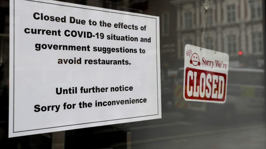 A sign on a closed restaurant in London, Tuesday, March 17, 2020.